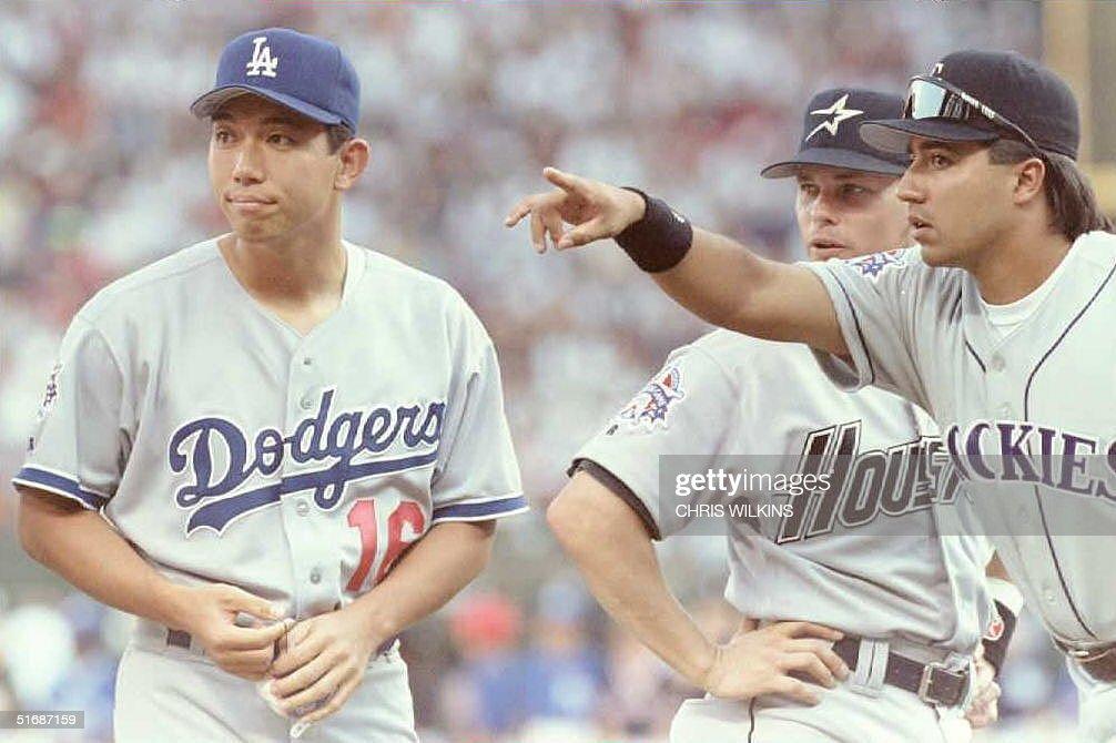National League AllStar teammates Vinny Castilla of the Colorado Rockies and Craig Biggio of the Houston Astros point starting pitcher Hideo Nomo...
