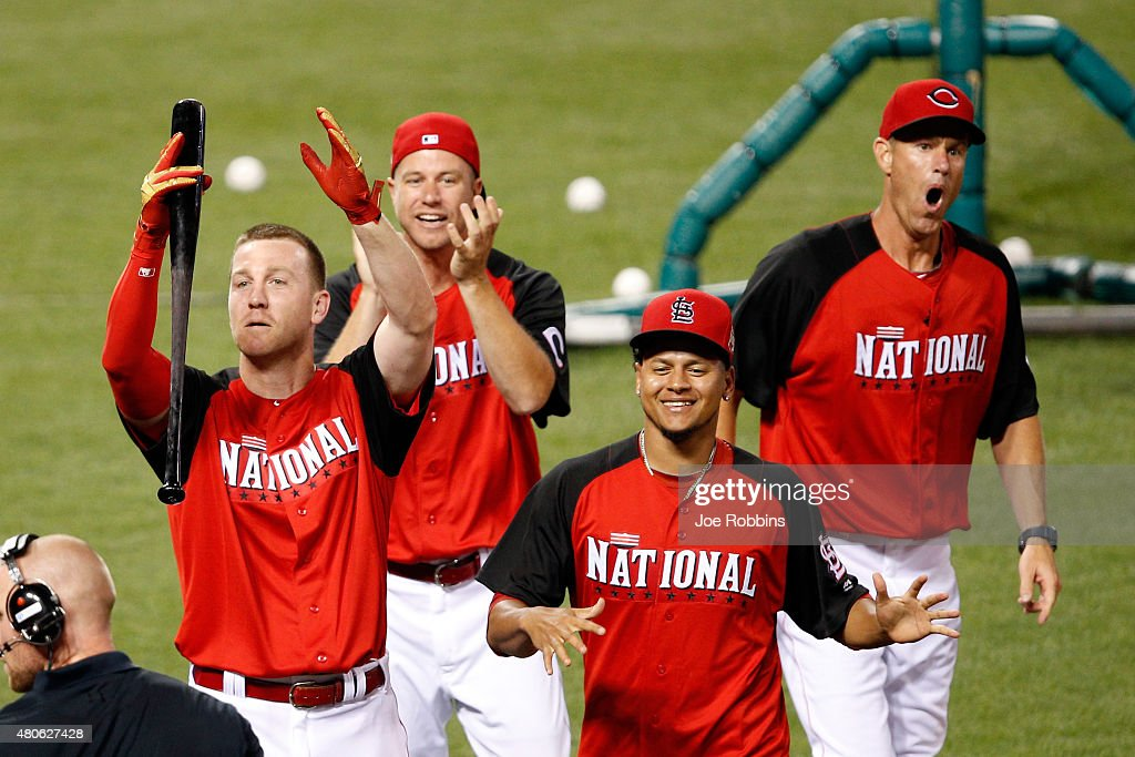 National League All-Star Todd Frazier #21 of the Cincinnati Reds celebrates with his brothers Jeff, Charlie and teammate National League All-Star Carlos Martinez #18 of the St. Louis Cardinals after winning the Gillette Home Run Derby presented by Head & Shoulders at the Great American Ball Park on July 13, 2015 in Cincinnati, Ohio.