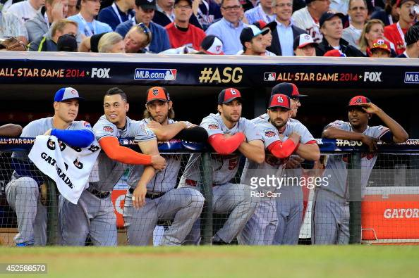 National League AllStars look on from the dugout during the 85th MLB AllStar Game at Target Field on July 15 2014 in Minneapolis Minnesota