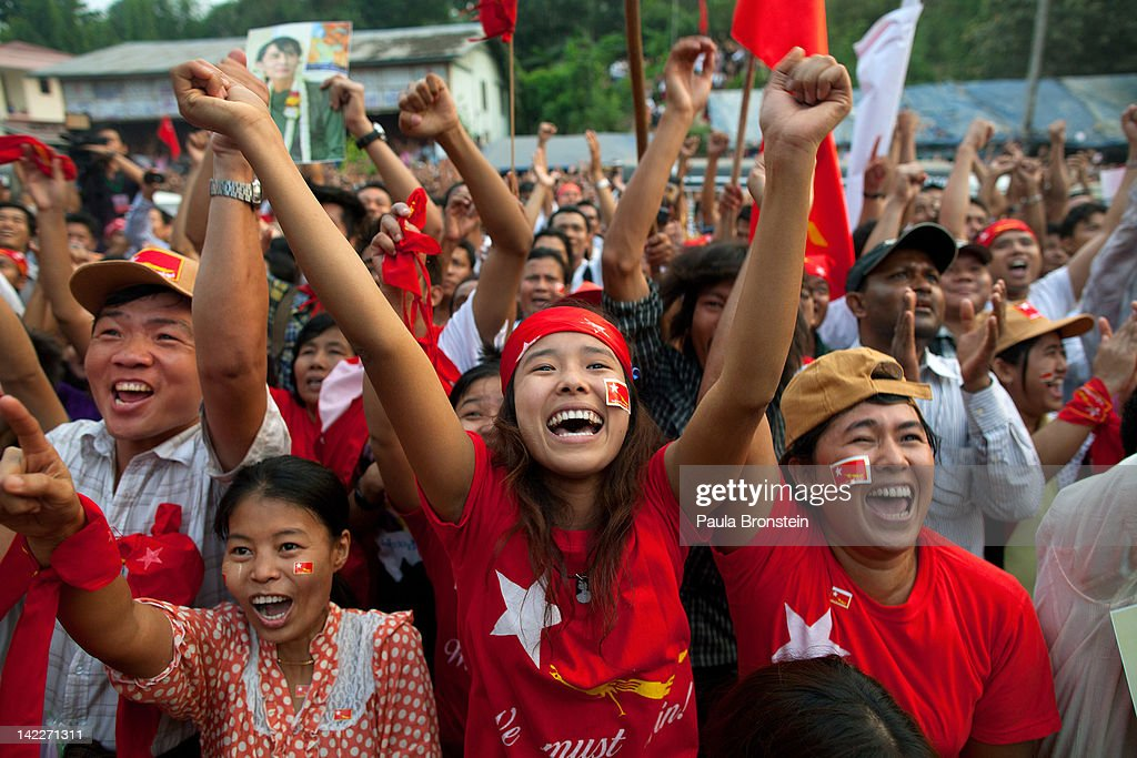 National League for Democracy supporters celebrate their victory in the parliamentary elections outside the party headquarters April 1 2012 in Yangon...