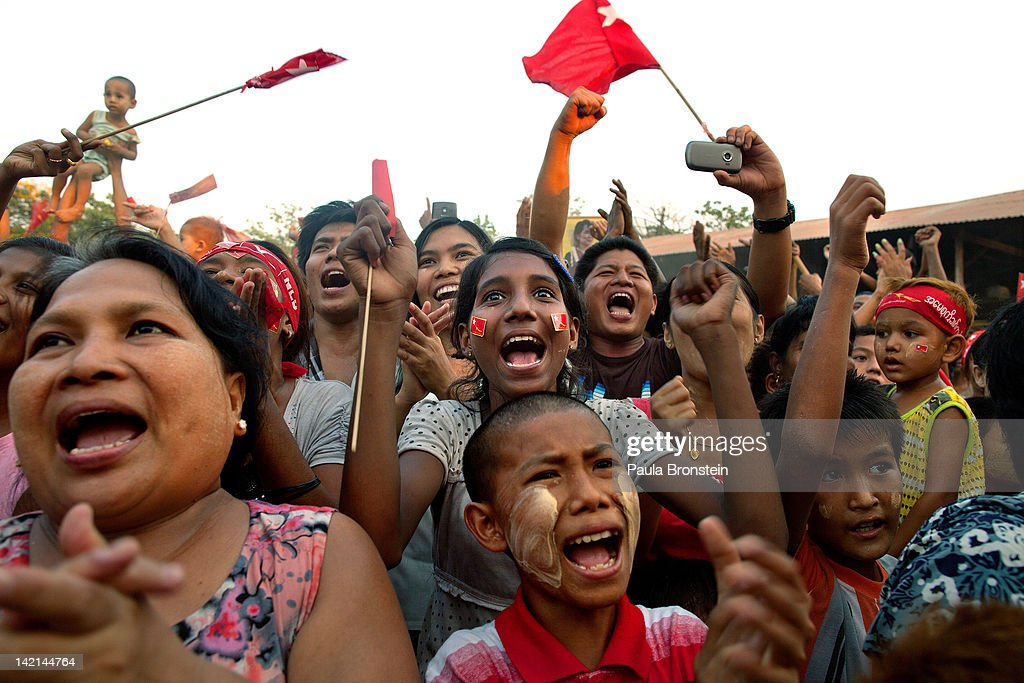 National League for Democracy supporters cheer during a political rally ahead of the parliamentary elections March 30 2012 in Yangon Myanmar During a...