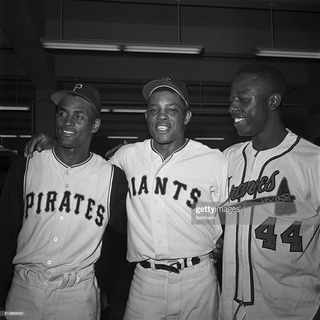 National League stars Roberto Clemente, Willie Mays, and Hank Aaron stand together for a victory portrait after the All-Star Game of 1961 in San Francisco.