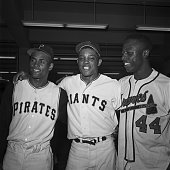 National League stars Roberto Clemente Willie Mays and Hank Aaron stand together for a victory portrait after the AllStar Game of 1961 in San...