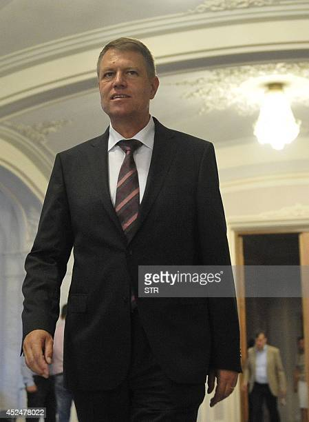 National Liberal Party's President Klaus Iohannis walk to PNL's permanent delegation at the Romanian Parliament in Bucharest on July 21 2014 Iohannis...