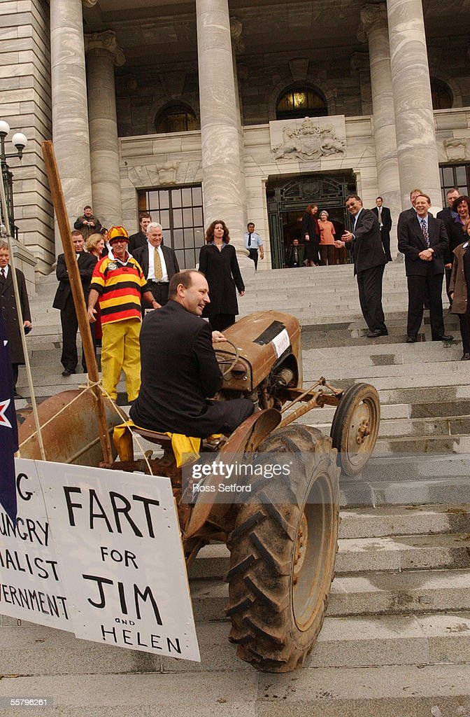 National MP Shane Ardern attempts to drive a tractor up the stairs of Parliament, Thursday during a protest by farmers against the so called 'fart' tax which will be levied as part of the Kyoto agreement.