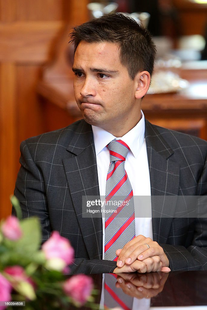 National MP Simon Bridges looks on during a swearing-in ceremony at Government House on January 31, 2013 in Wellington, New Zealand. After a recent Cabinet reshuffle by Prime Minister John Key, Dr Nick Smith was appointed Minister of Housing, Nikki Kaye was appointed Minister for Food Safety, Youth Affairs and Civil Defence while Michael Woodhouse was appointed as a Minister, outside of Cabinet, for Immigration and Veterans Affairs.