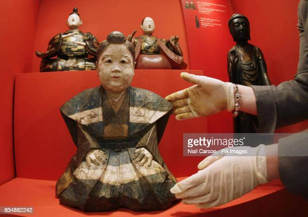 National Museum of Ireland curator Audrey Whitty handles a Camphor wood figure of Shotoku Taishi dating from 1750 AD which forms part of the Albert...