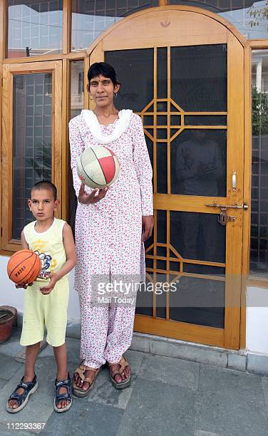 National Netball Player Swetlana with her son Karan at her residence in Defence Colony 7'3'' tall Swetlana is the second tallest woman alive