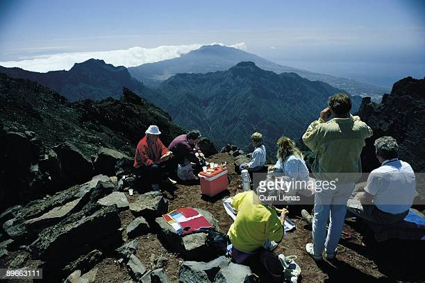 National Park of the Caldera de Taburiente family of tourists eats and they observe the landscape of National Park of the Caldera de Taburiente in La...