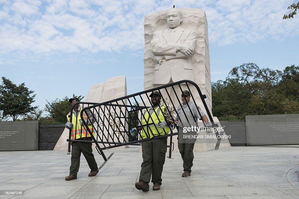 US National Park Service employees close the Martin Luther King Jr. Memorial on the National Mall October 1, 2013 in Washington, DC. The US government is in a forced shutdown after lawmakers failed to pass a spending bill last night. AFP PHOTO/Brendan SMIALOWSKI