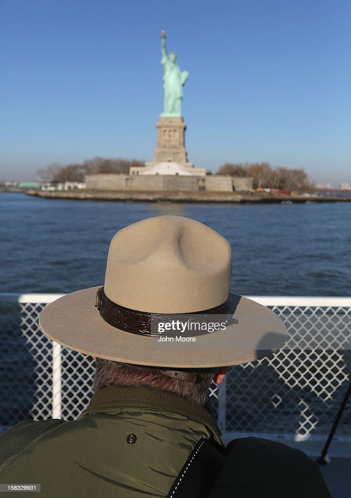 A National Park Service ranger looks towards the Statue of Liberty which, remains closed to the public six weeks after Hurricane Sandy on December 13, 2012 in New York City. The storm caused extensive damage to National Park Service facilities on Liberty Island, although the statue itself remained unscathed. U.S. Secretary of the Interior Ken Salazar toured the island Thursday while visiting the area to see damage caused by the storm.