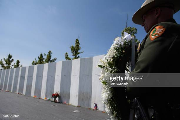 National Park Service Ranger presents a wreath at the Flight 93 National Memorial on the 16th Anniversary ceremony of the September 11th terrorist...