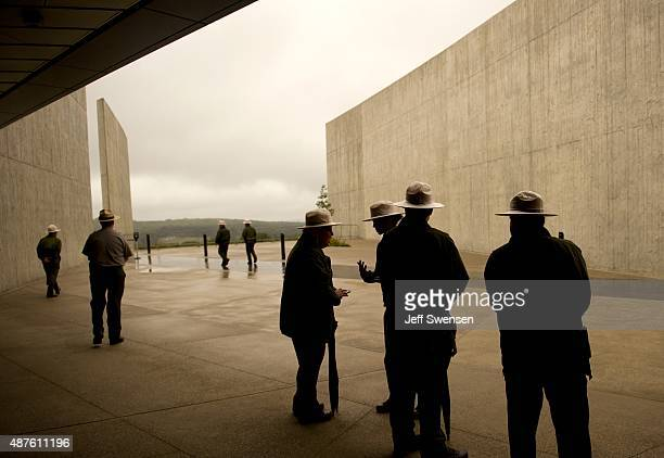 National Park Service rangers wait for family members of the crash victims and dignitaries at the visitor center at the Flight 93 National Memorial...
