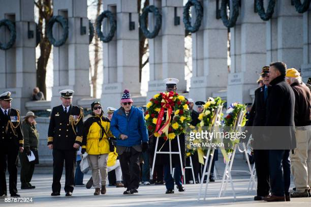 National Park Service volunteer escorts Retired Army Col Edward Padelford as he places a wreath during a ceremony held by the Friends of the National...