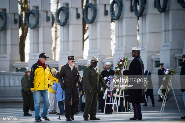 National Park Service volunteer escorts Retired Army Col Fred Clinton as he places a wreath during a ceremony held by the Friends of the National...