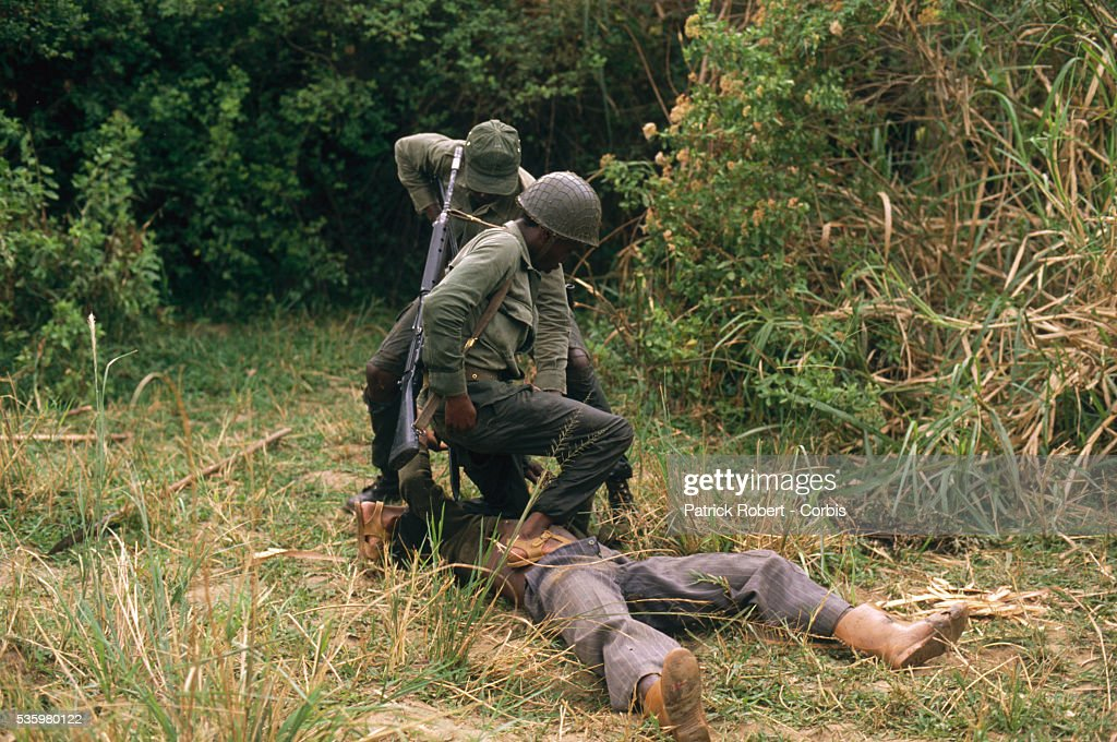 National Parks Guards arrest a poacher in Zaire. The national parks continue to struggle against the poaching of elephants and the traffic of ivory in Zaire (now the Democratic Republic of Congo).