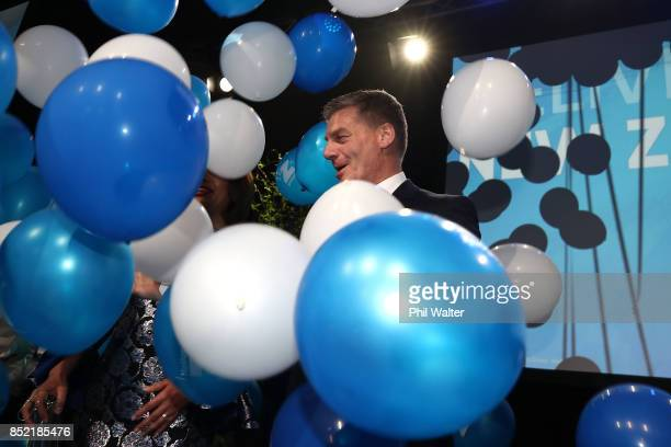 National Party leader Bill English waves to his supporters on September 23 2017 in Auckland New Zealand With results too close to call no outright...