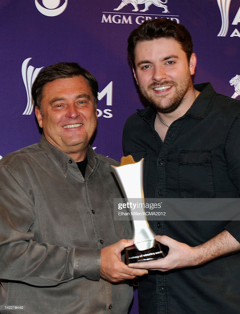National Personality of The Year Lon Helton accepts award from singer Chris Young onstage during ACM Radio Awards Reception at the MGM Grand Hotel/Casino on March 31, 2012 in Las Vegas, Nevada.