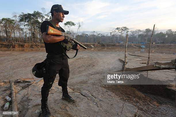 National Police officer searches an illegal mining operation in the Amazon lowlands on November 17 2013 in Madre de Dios region Peru Police...