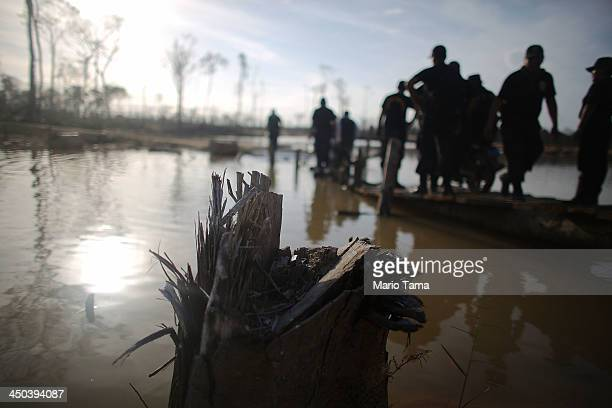 National Police officers search for illegal mining operations in deforested areas in the Amazon lowlands on November 17 2013 in Madre de Dios region...