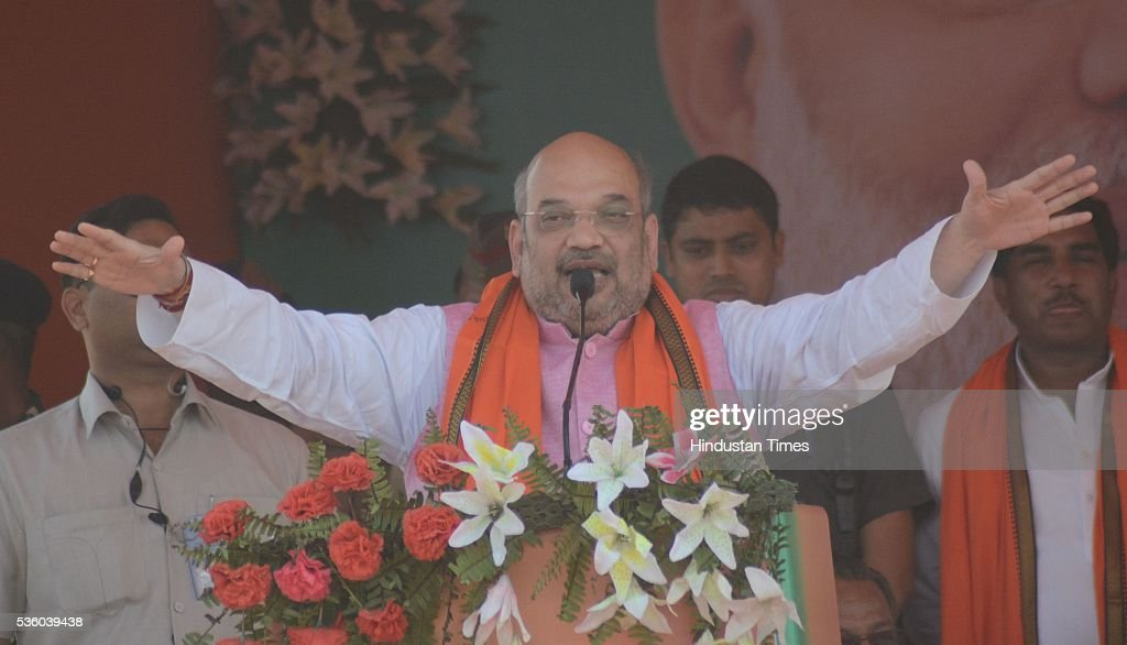 National President Amit Shah addressing the Sardar Patel Kisan Mahasammelan at Andawa area in Jhunsi on May 31, 2016 in Allahabad, India. On his way to rally, BJP chief Amit Shah had lunch with Dalit and backward class members in a dusty village in Varanasi. The event was not elaborate but the symbolism was hard to miss that party is reaching out to caste groups not counted among its core supporters ahead of the crucial 2017 assembly election in Uttar Pradesh.