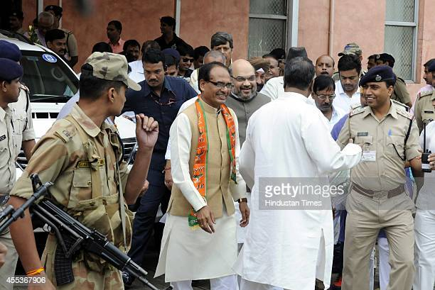 BJP national president Amit Shah along with Madhya Pradesh chief minister Shivraj singh Chouhan at Indore airport on September 13 2014 in Indore...