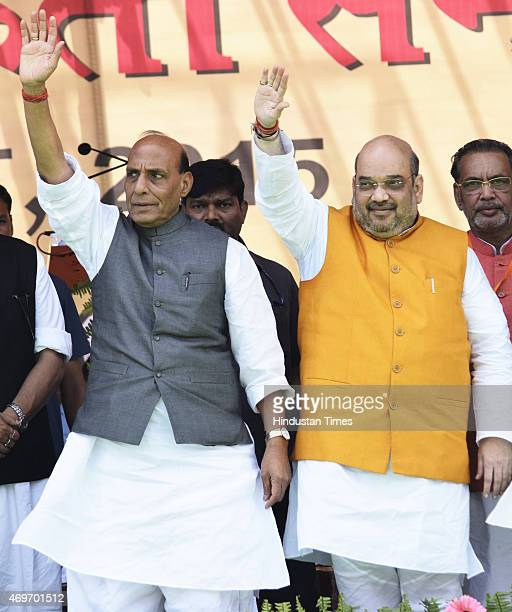 National President Amit Shah and Union Home Minister Rajnath Singh wave during the party workers' convention at Gandhi Maidan on April 14 2015 in...