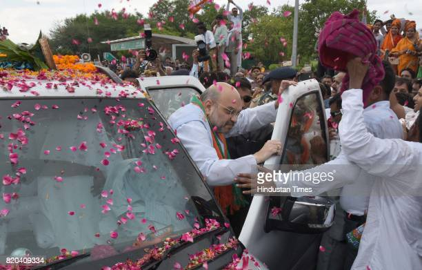 National President Amit Shah being welcomed by party men on his way in a procession from Sanganer Airport to party office on the first day of his...
