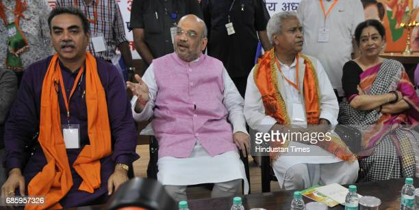National President Amit Shah Chandigarh MP Kirron Kher with local leaders after inaugurating the newlyrenovated hitech BJP office in the city on May...