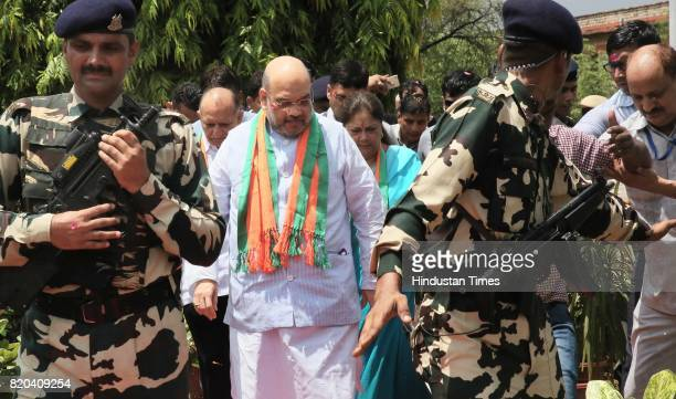 National President Amit Shah followed by CM Vasundhara Raje stops to pay tribute to Mahatma Gandhi while on his way in a procession from Sanganer...