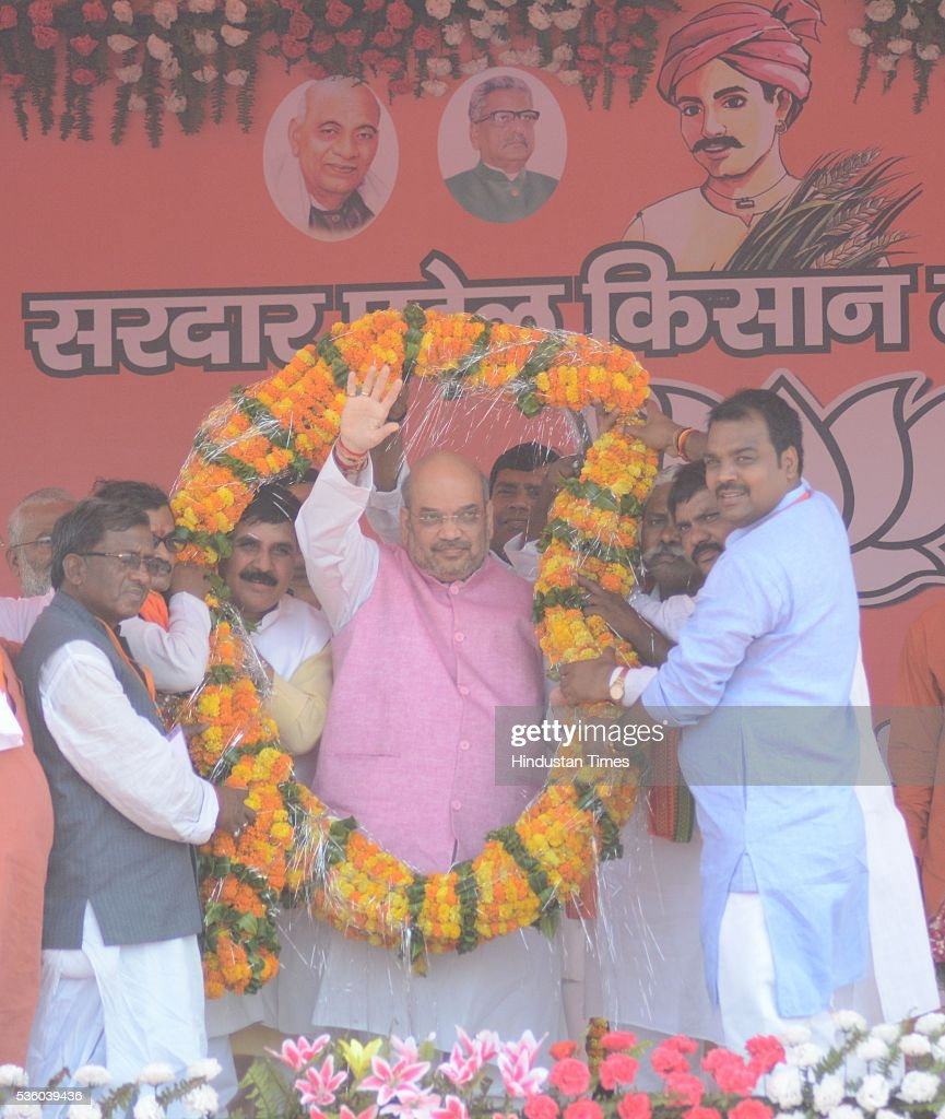 National President Amit Shah greets people at the Sardar Patel Kisan Mahasammelan at Andawa area in Jhunsi on May 31, 2016 in Allahabad, India. On his way to rally, BJP chief Amit Shah had lunch with Dalit and backward class members in a dusty village in Varanasi. The event was not elaborate but the symbolism was hard to miss that party is reaching out to caste groups not counted among its core supporters ahead of the crucial 2017 assembly election in Uttar Pradesh.
