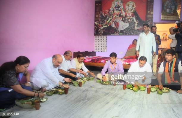 National President Amit Shah having lunch at a dalit's home along with CM Vasundhara Raje and state President Ashok Parnami and Central Minister...