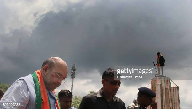 National President Amit Shah pays tribute to Father of the Nation Mahatma Gandhi while on his way from Sanganer Airport to party office on the first...