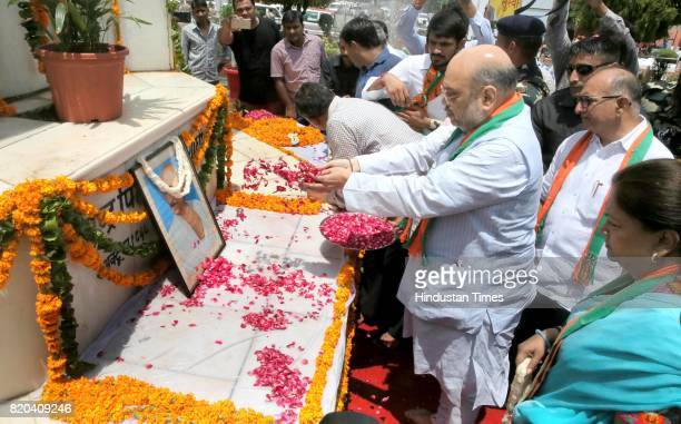 National President Amit Shah pays tribute to Father of the Nation Mahatma Gandhi as CM Vasundhara Raje and State BJP President Ashok Parnami look on...