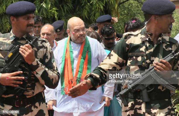 National President Amit Shah stops to pay tribute to Mahatma Gandhi while on his way in a procession from Sanganer Airport to party office on the...