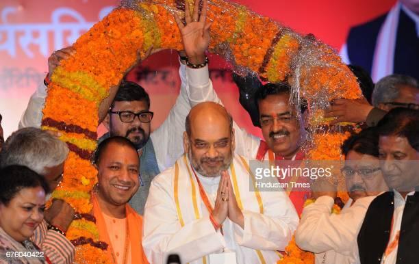 National President Amit Shah Uttar Pradesh Chief Minister Yogi Adityanath and Uttar Pradesh Deputy Chief Minister Keshav Prasad Maurya during the...