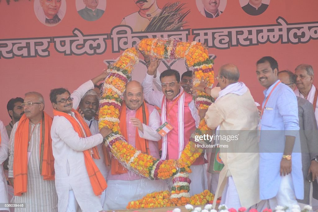 National President Amit Shah with BJP UP President Keshav Prasad Maurya during the Sardar Patel Kisan Mahasammelan at Andawa area in Jhunsi on May 31, 2016 in Allahabad, India. On his way to rally, BJP chief Amit Shah had lunch with Dalit and backward class members in a dusty village in Varanasi. The event was not elaborate but the symbolism was hard to miss that party is reaching out to caste groups not counted among its core supporters ahead of the crucial 2017 assembly election in Uttar Pradesh.