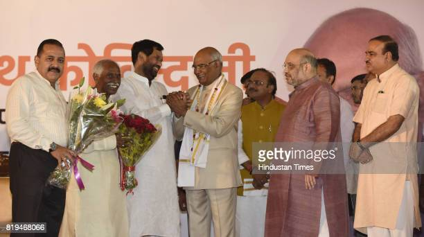 National President Amit Shah with other union ministers greets newly elected President of India Ram Nath Kovind after his win in Presidential...