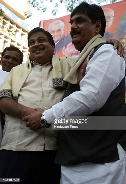 BJP National President Nitin Gadkari and BJP leader Gopinath Munde greets each other on December 26 2009 in Mumbai India Union Rural Development...
