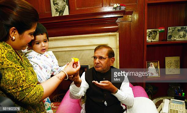 National President of Janata Dal Sharad Yadav's daughter and grand daughter offering him 'Laddoo' at his residence as grand alliance heading towards...