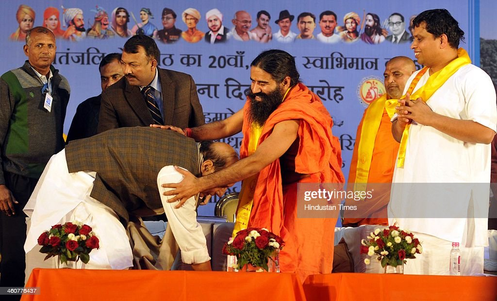 BJP National President Rajnath Singh and Yog Guru Baba Ramdev at the 5th foundation day celebrations of 'Bharat Swabhiman' on January 5, 2014 in New Delhi, India. Launching a fresh offensive against the Congress, Modi said, ''Dont trust anyone because of mere promises. Judge the track-record, and not tape record.' Modi promised to review and reform of the taxation system in the country, saying the existing structure is a burden on common man. Modi pointed out Ramdev, who had said his support to the saffron party would be issue-based, had joined the peoples movement. Modi further said, We have the will-power to transform the country. The way to end corruption is by making the state progressive and policy driven.'