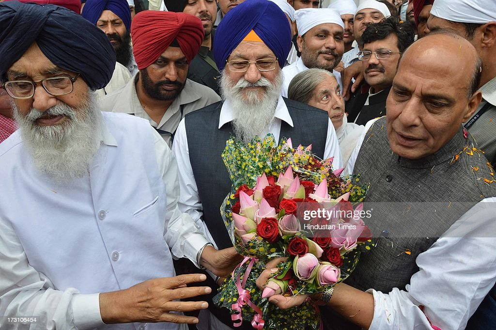 BJP National President Rajnath Singh being welcome by the Chief Minister Punjab Parkash Singh Badal and SGPC president Avtar Singh Makkar with a bouquet outside Golden Temple complex on July 7, 2013 in Amritsar, India. BJP leaders discuss all the matters relating the preparedness for the next parliamentary polls and its ties with the alliance partner in the state Shiromani Akali Dal (Badal).