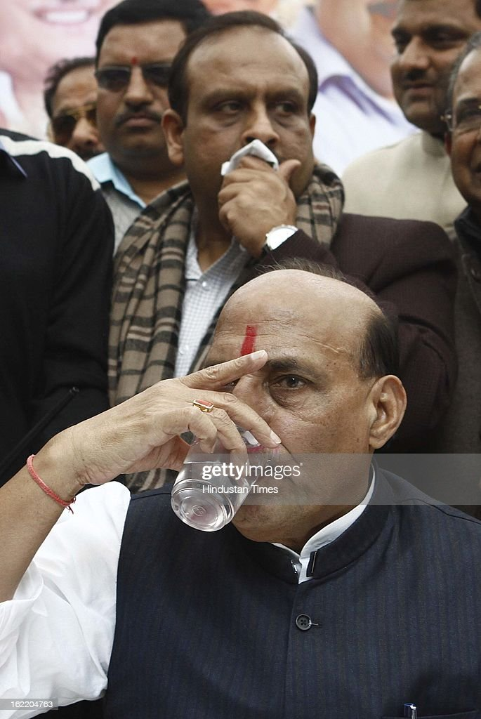 BJP National President Rajnath Singh drinks water at a rally in protest against Union Home Minister Sushil Kumar Shinde's remarks linking saffron terror to BJP and RSS, at Jantar Mantar on February 20, 2013 in New Delhi, India. Stepping up the attack on Shinde ahead of the Budget session the BJP president said that the comments were part of a conspiracy to divide the nation for votebank politics and demanded an apology from Home Minister.