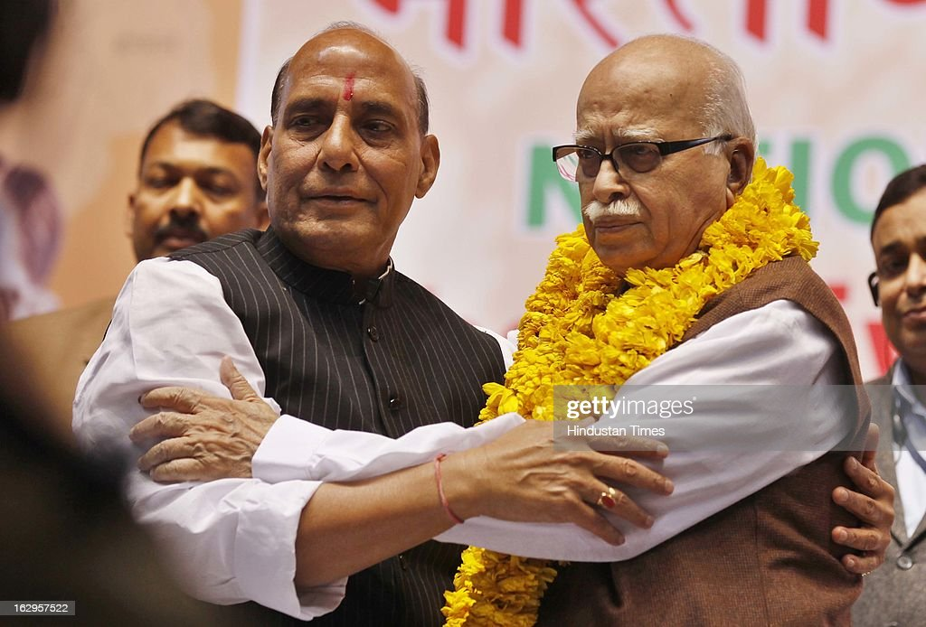 BJP national President Rajnath Singh (L) greets LK Advani during Bharatiya Janata Party National Council meeting at Talkatora Indoor Stadium on March 2, 2013 in New Delhi, India. In his 90 minute presidential address Rajnath Singh asked the party ranks to be prepared for early Lok Sabha polls and crucial assembly elections this year, including in Karnataka, Madhya Pradesh, Chhattisgarh, Rajasthan and Delhi all very important states for BJP.