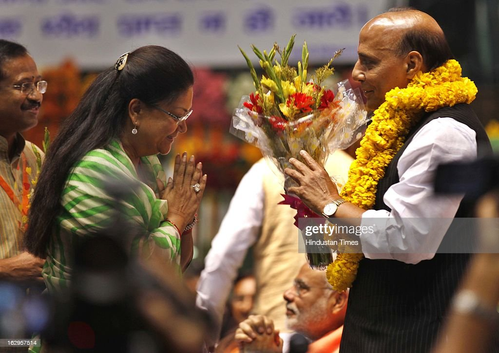 BJP national President Rajnath Singh greets Rajasthan BJP chief Vasundhara Raje during Bharatiya Janata Party National Council meeting at Talkatora Indoor Stadium on March 2, 2013 in New Delhi, India. In his 90 minute presidential address Rajnath Singh asked the party ranks to be prepared for early Lok Sabha polls and crucial assembly elections this year, including in Karnataka, Madhya Pradesh, Chhattisgarh, Rajasthan and Delhi all very important states for BJP.