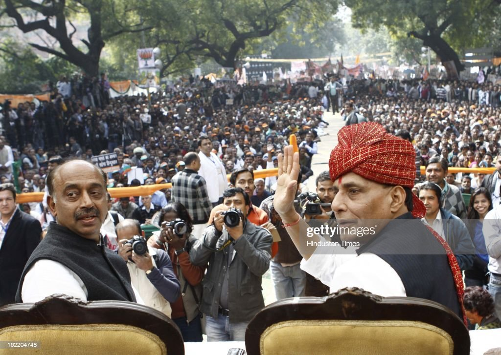 BJP National President Rajnath Singh greets the supporters as Delhi BJP President Vijay Goel looks at a rally in protest against Union Home Minister Sushil Kumar Shinde's remarks linking saffron terror to BJP and RSS, at Jantar Mantar on February 20, 2013 in New Delhi, India. Stepping up the attack on Shinde ahead of the Budget session the BJP president said that the comments were part of a conspiracy to divide the nation for votebank politics and demanded an apology from Home Minister.