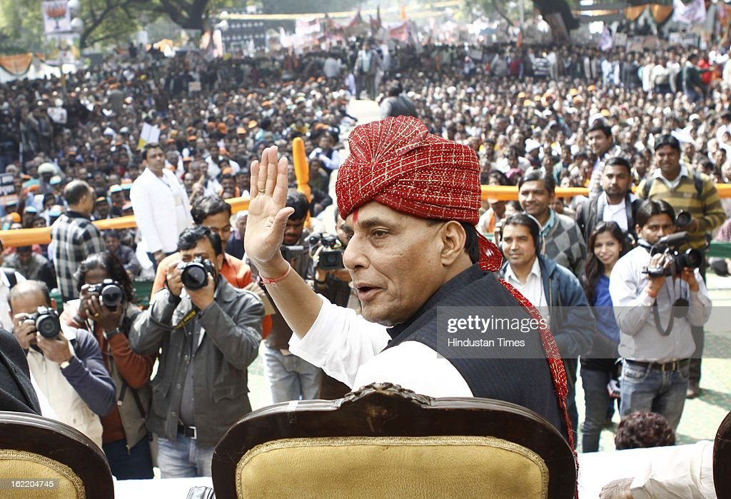 BJP National President Rajnath Singh greets the supporters at a rally in protest against Union Home Minister Sushil Kumar Shinde's remarks linking saffron terror to BJP and RSS, at Jantar Mantar on February 20, 2013 in New Delhi, India. Stepping up the attack on Shinde ahead of the Budget session the BJP president said that the comments were part of a conspiracy to divide the nation for votebank politics and demanded an apology from Home Minister.
