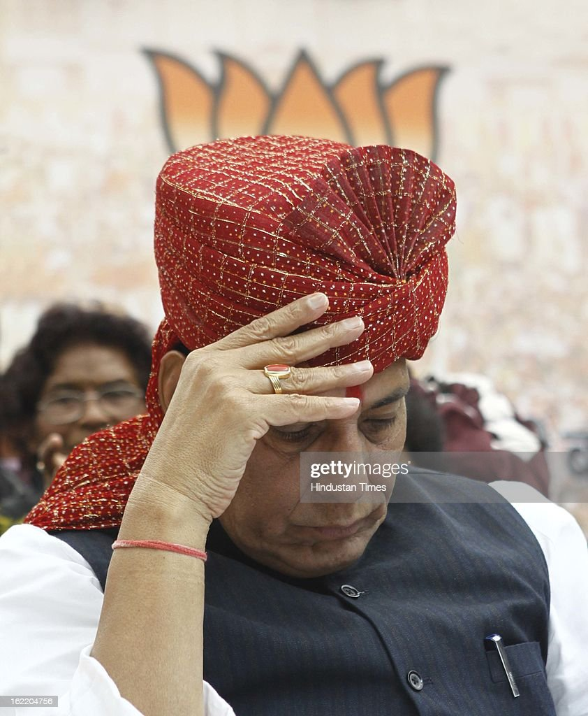 BJP National President Rajnath Singh reacts at a rally in protest against Union Home Minister Sushil Kumar Shinde's remarks linking saffron terror to BJP and RSS, at Jantar Mantar on February 20, 2013 in New Delhi, India. Stepping up the attack on Shinde ahead of the Budget session the BJP president said that the comments were part of a conspiracy to divide the nation for votebank politics and demanded an apology from Home Minister.