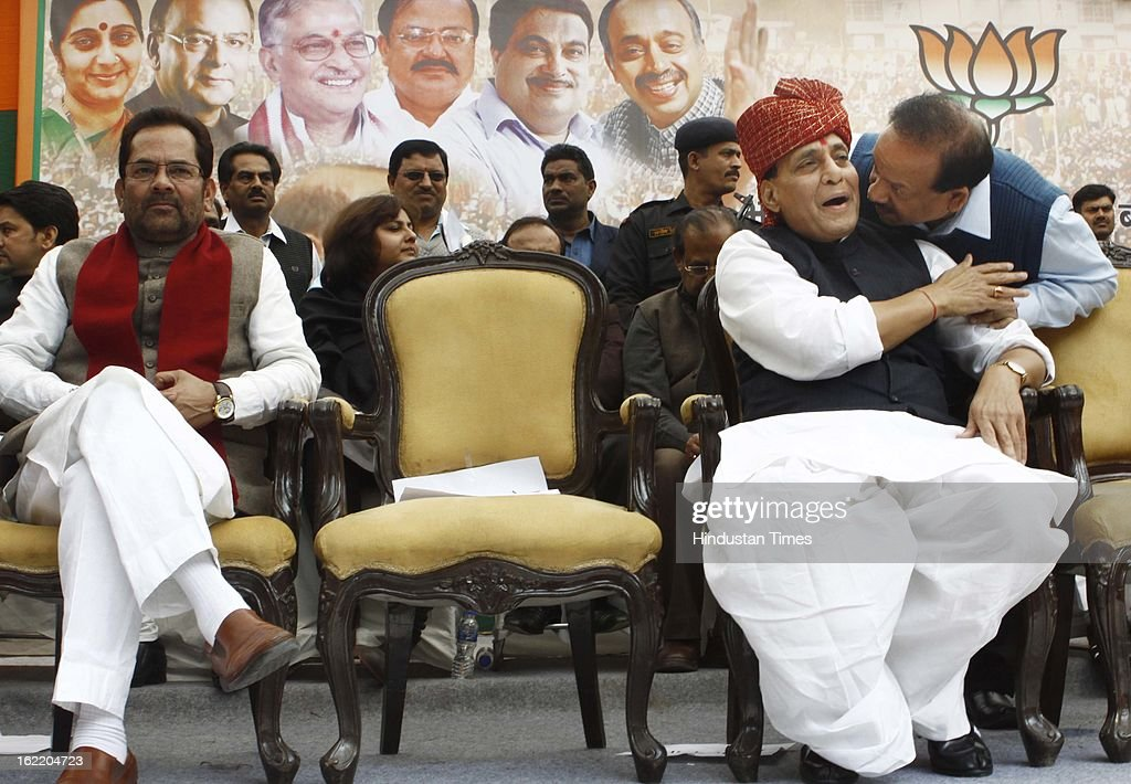 BJP National President Rajnath Singh talks to former Delhi BJP chief Harsh Vardhan as senior leader Mukhtar Abbas Naqvi looks on at a rally in protest against Union Home Minister Sushil Kumar Shinde's remarks linking saffron terror to BJP and RSS, at Jantar Mantar on February 20, 2013 in New Delhi, India. Stepping up the attack on Shinde ahead of the Budget session the BJP president said that the comments were part of a conspiracy to divide the nation for votebank politics and demanded an apology from Home Minister.