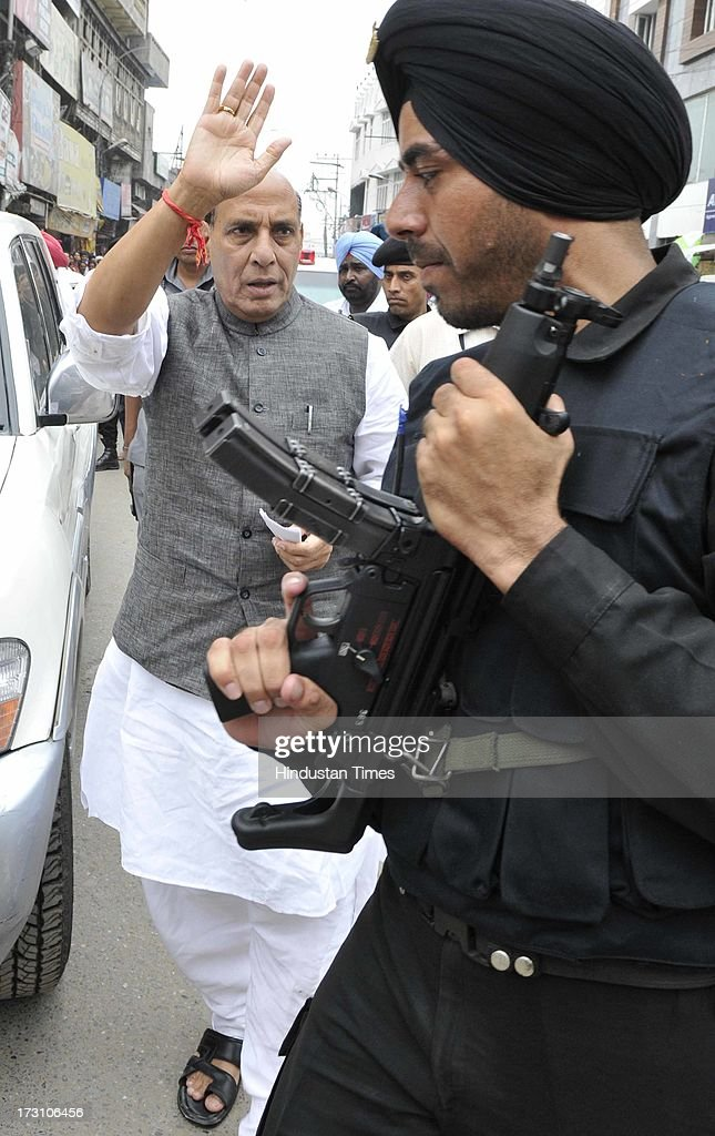 BJP National President Rajnath Singh waves to his supporters as going to pay tribute to the martyrs of Jallianwala Bagh before attending BJP State executive meeting on July 7, 2013 in Amritsar, India. BJP leaders discuss all the matters relating the preparedness for the next parliamentary polls and its ties with the alliance partner in the state Shiromani Akali Dal (Badal).